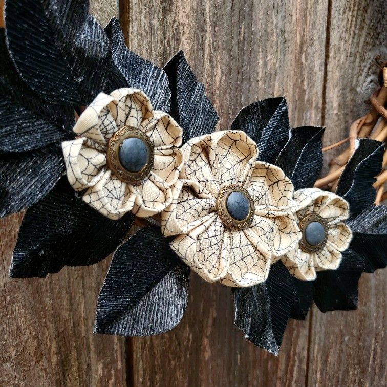 Hand sewn fabric flowers with vintage button centers, crepe paper foliage #crepepaper #cartefini #kanzashi #vintagebuttons #spiderwebs #spookyseason #fabricflowers #repurposedvintage