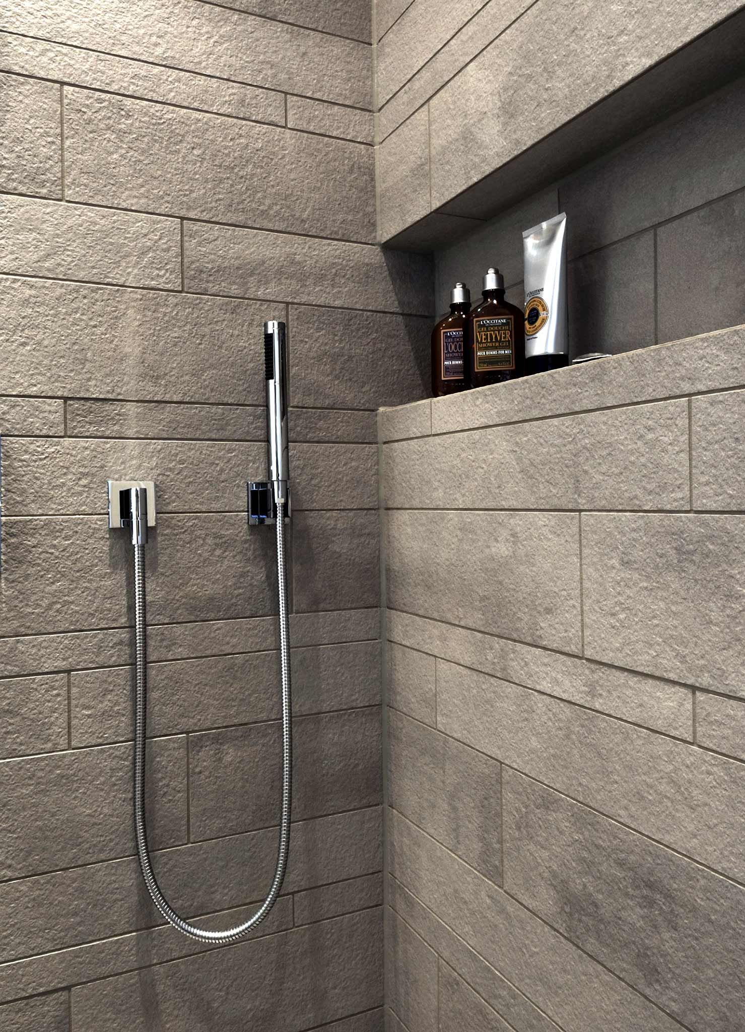 ausschnitt der dusche mit grauen fliesen in steinoptik nische f r pflegeprodukte badezimmer. Black Bedroom Furniture Sets. Home Design Ideas