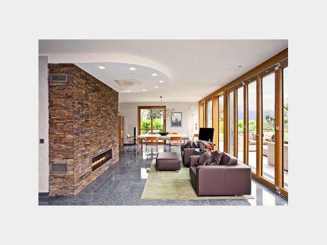 der designkamin verbindet wohnlounge mit esszimmer verleiht modernes landhaus flair und hlt an kalten - Landhaus Flair