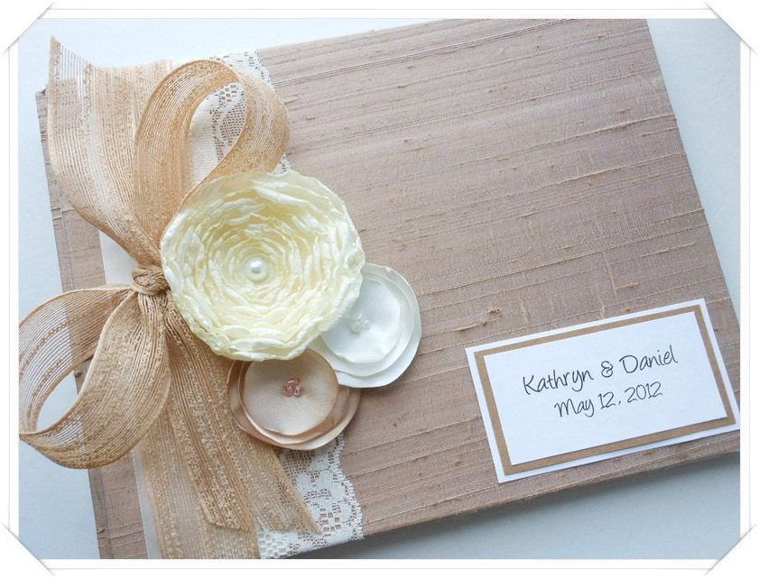 Custom Wedding Guest Book Tan Brown Burlap Bow and Flowers (made to order). $45.00, via Etsy.