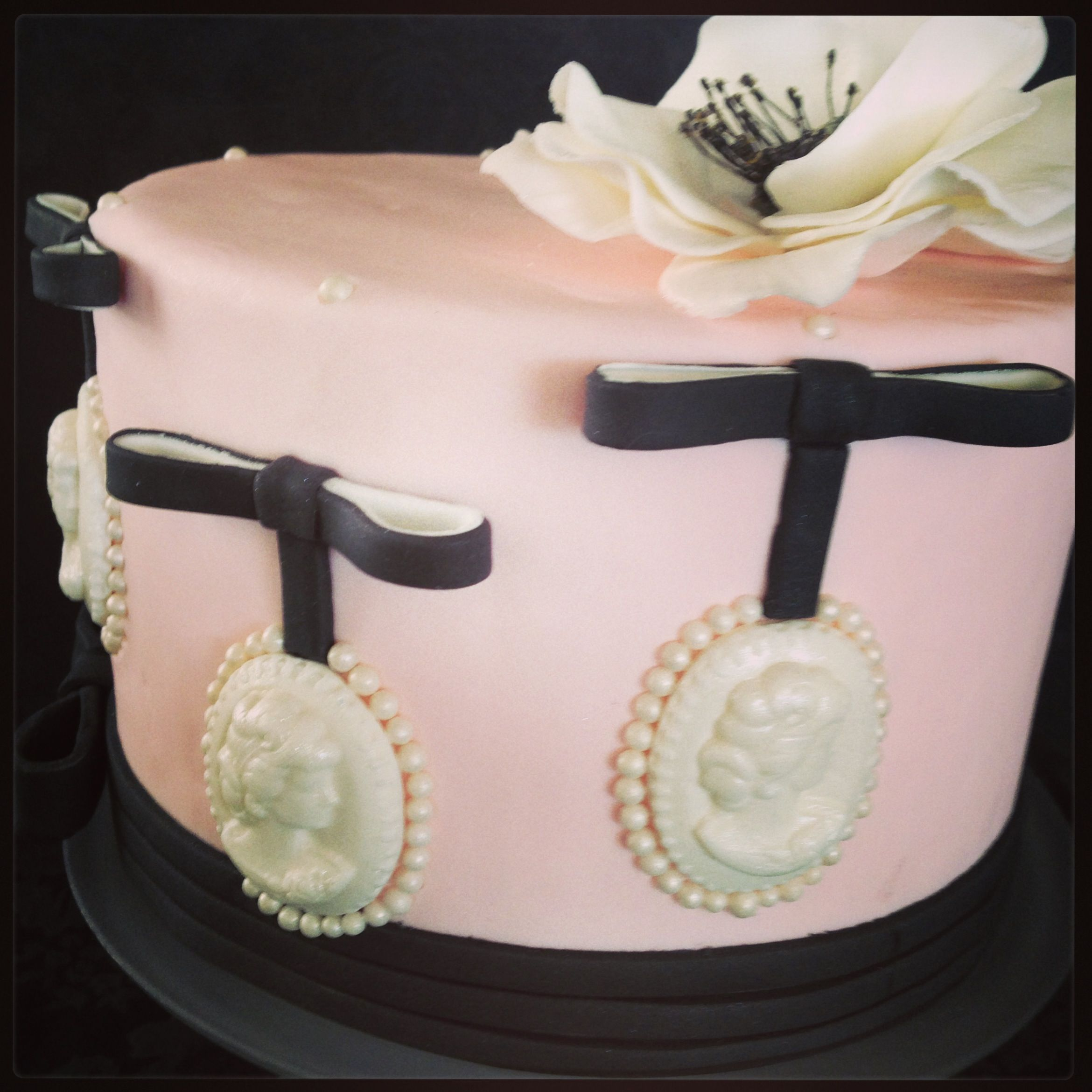 cameo cake with white anemone topper black, pink and white cake bows, cameos, cake, fondant