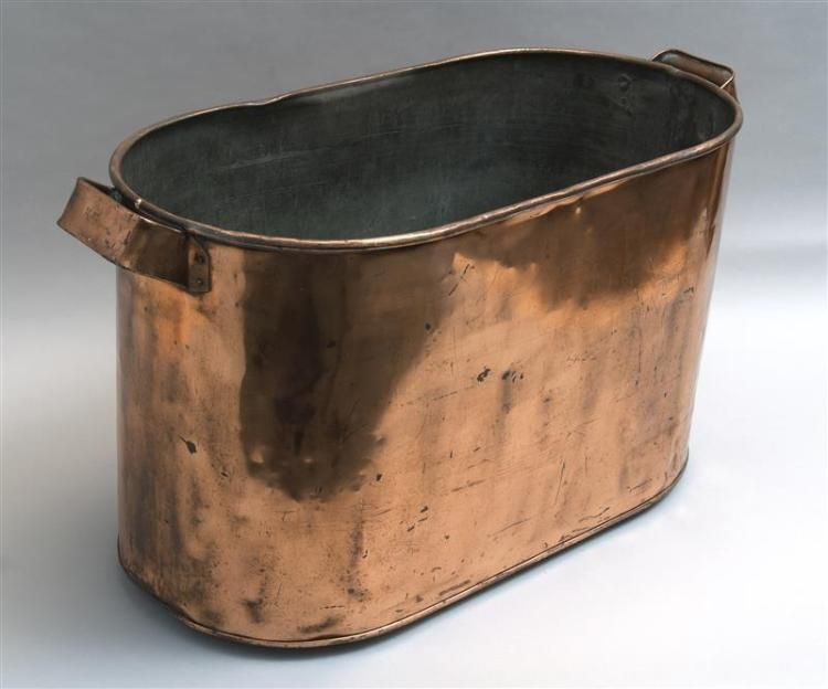 Antique copper bucket in oval form with applied copper