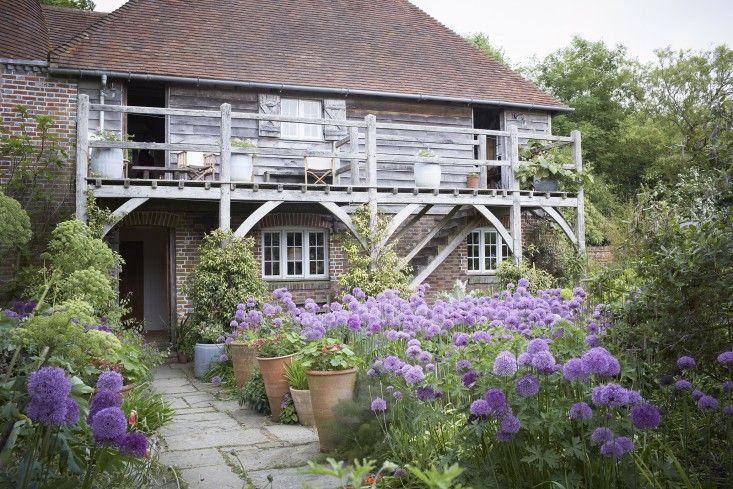 Perch Hill Farm Garden Visit   Gardenista. Large pots nestled in plantings.