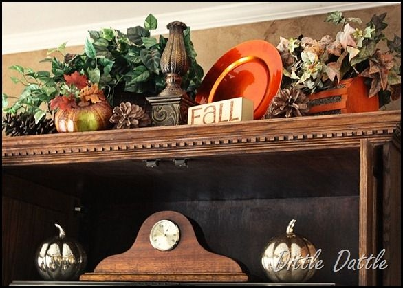 Top of the entertainment center decor. | Decorating above ...