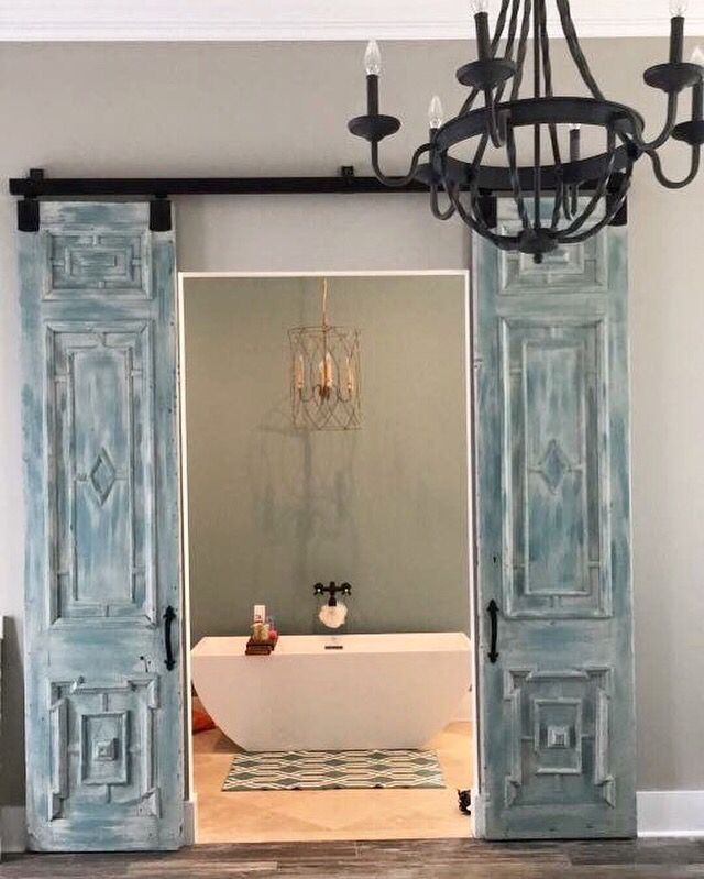 our antique french doors customized and hung barn door style for