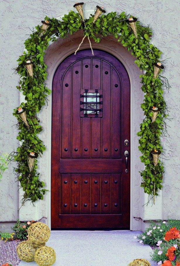 Decoration Ideas, Lovely Wooden Front Door With Green Garland With Gold  Trumpet: Surprising Front