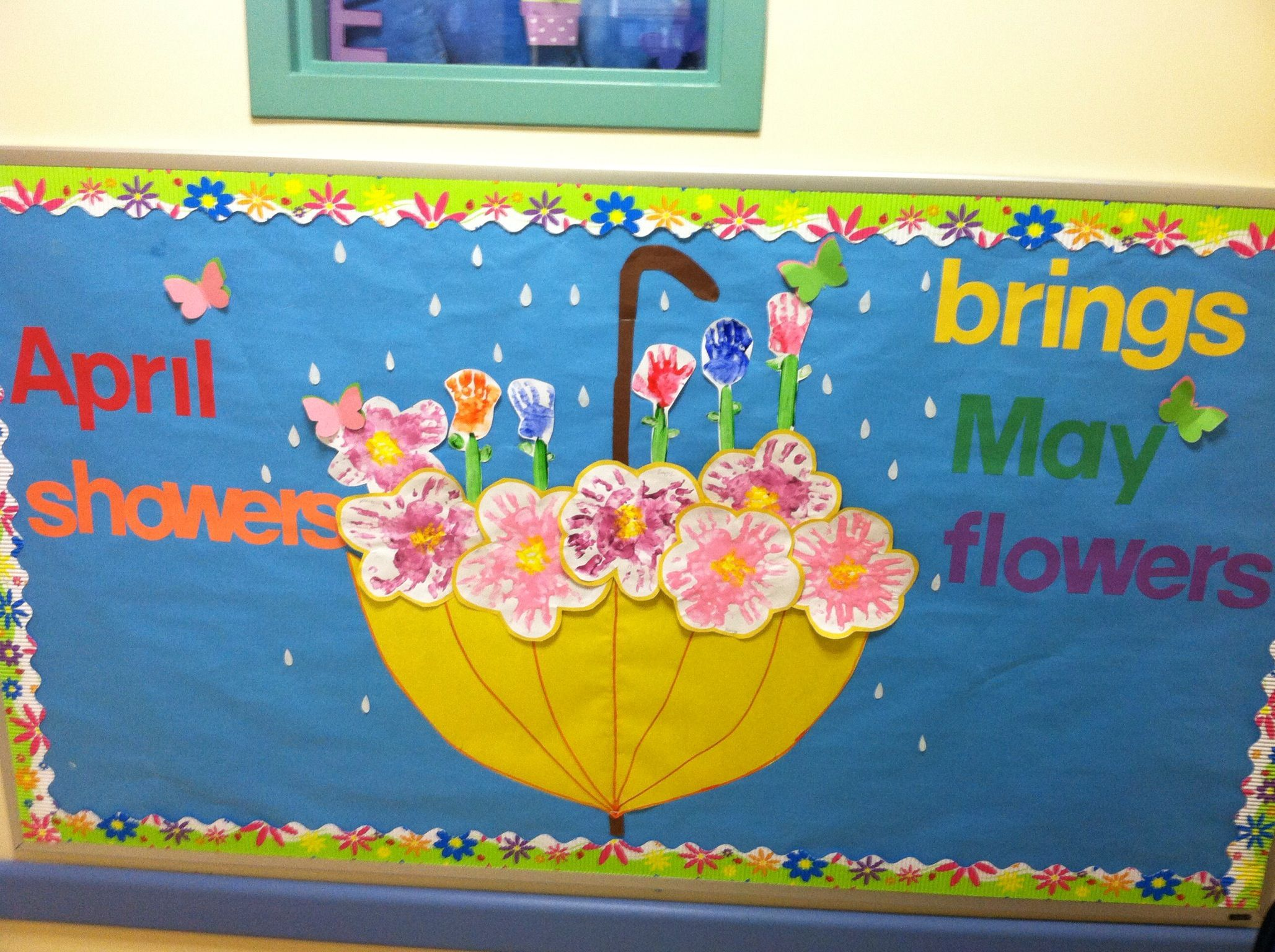 April May Bulletin Board Flowers Made By Hand Prints Birthday Bulletin Boards Spring Bulletin Boards Bulletin Boards Classroom Door