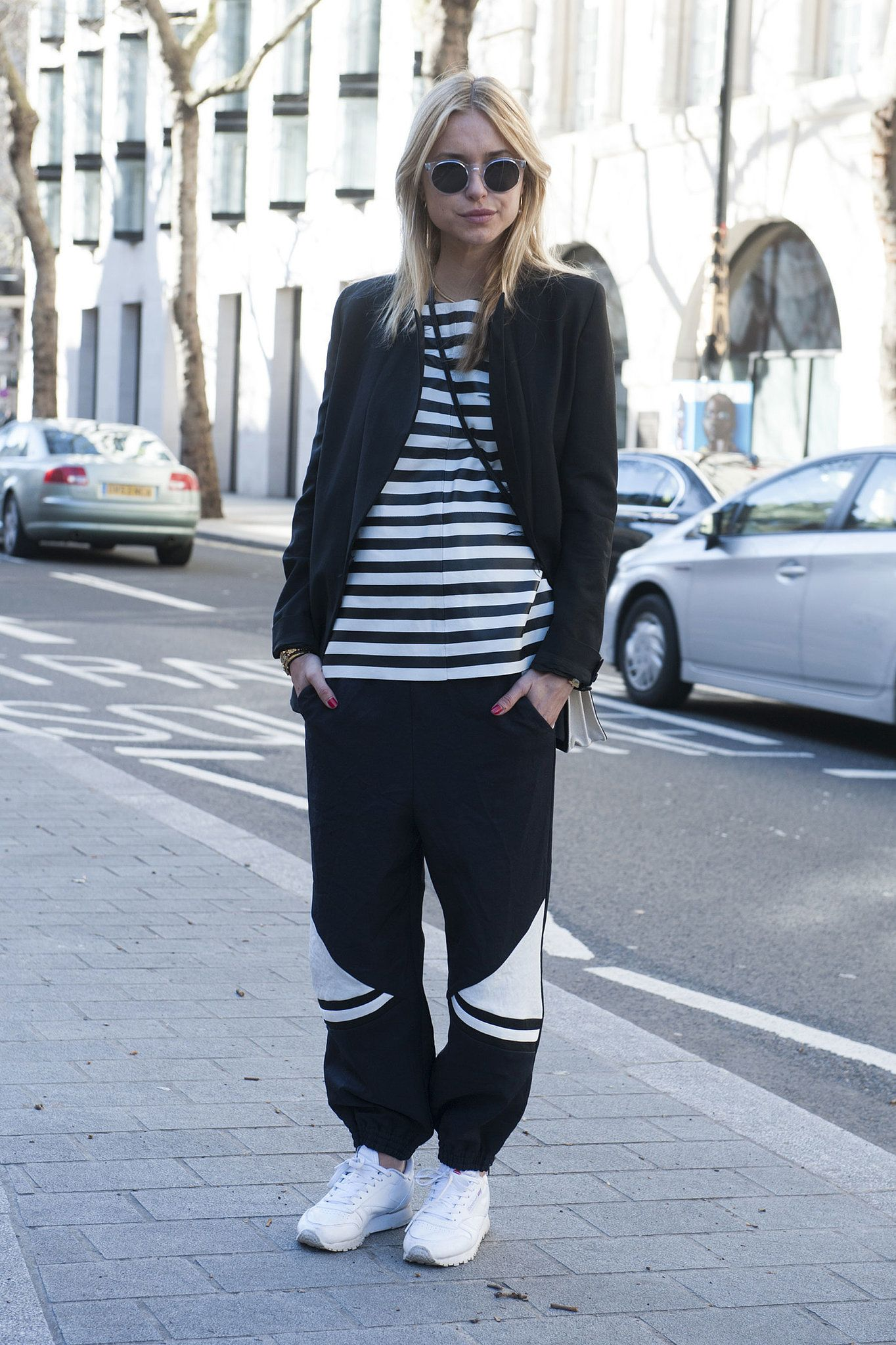 Pernille Teisbæk played it sporty-chic in track pants, sneakers, and classic stripes. Street Style at London Fashion Week #LFW