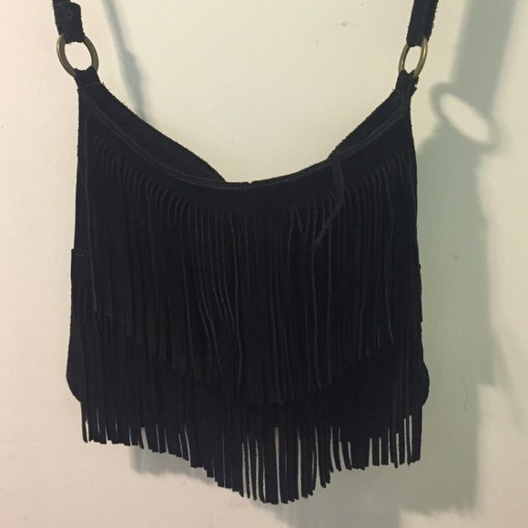Fringe suede cross body bag Black suede cross body bag with gold hardware. Have been used but shows no color fading or wear. Brandy Melville Bags Crossbody Bags
