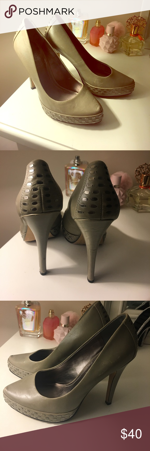 Vince camuto heels Grey leather heels with silver accents on platform . Bought from another posher but they weren't the size described . Look great with minor scuffing. I wish they were my size Vince Camuto Shoes Heels