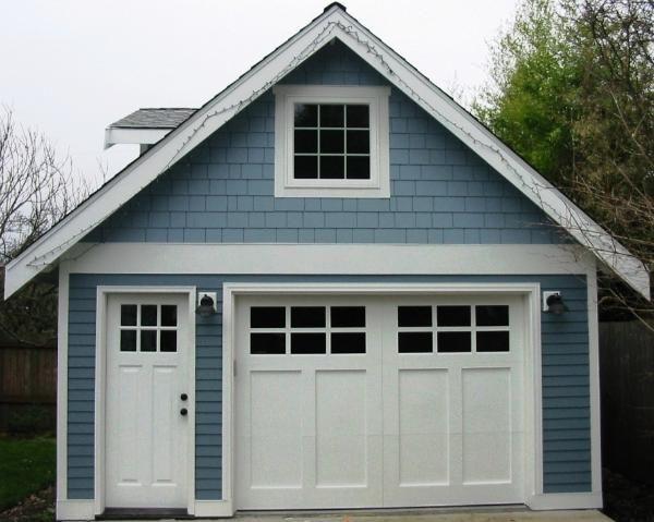 Hand made custom wood garage doors and real carriage house for Garage man door