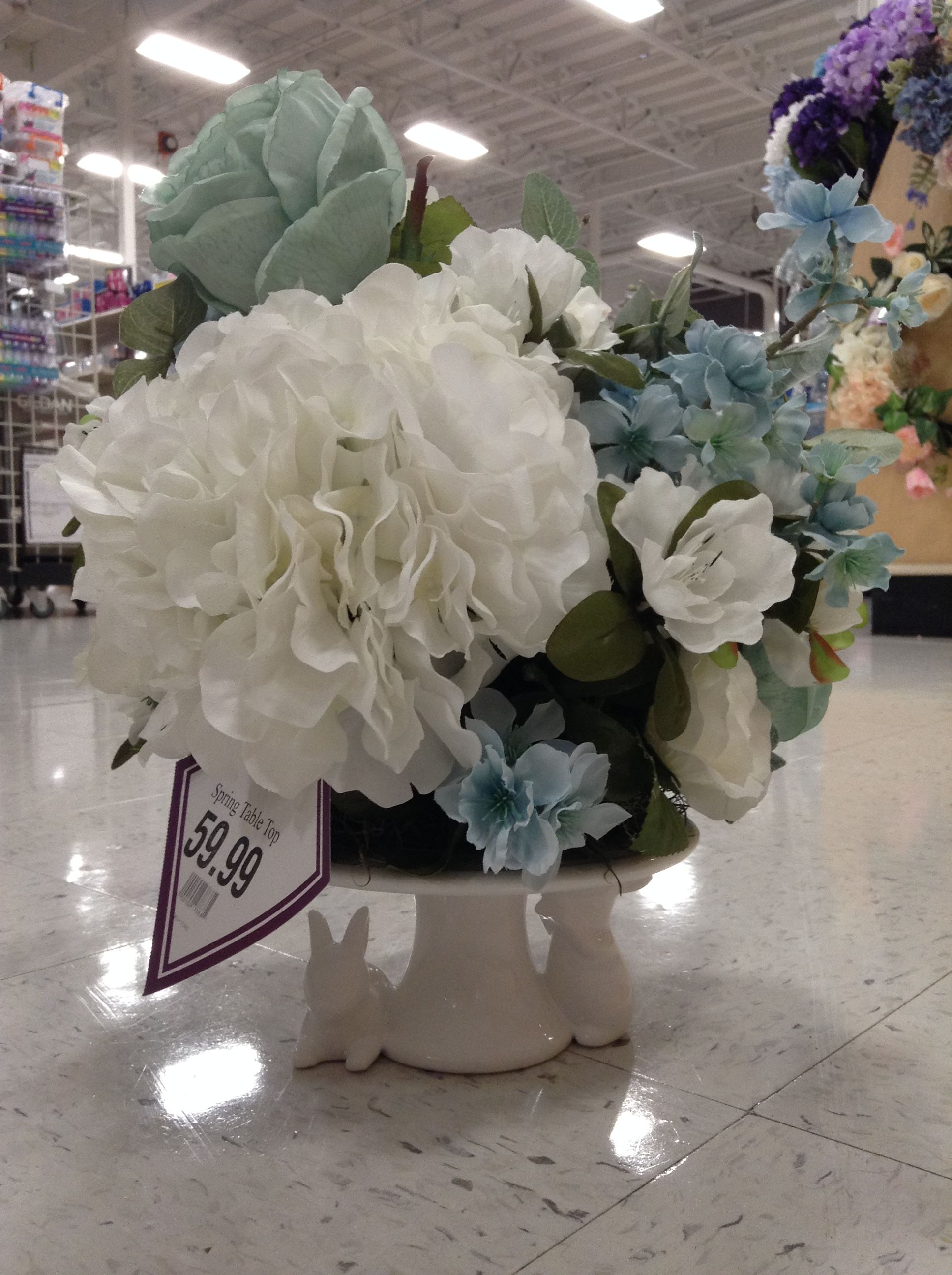 Floral Arrangement Of Dusty Blue Flowers And White Hydrangeas On