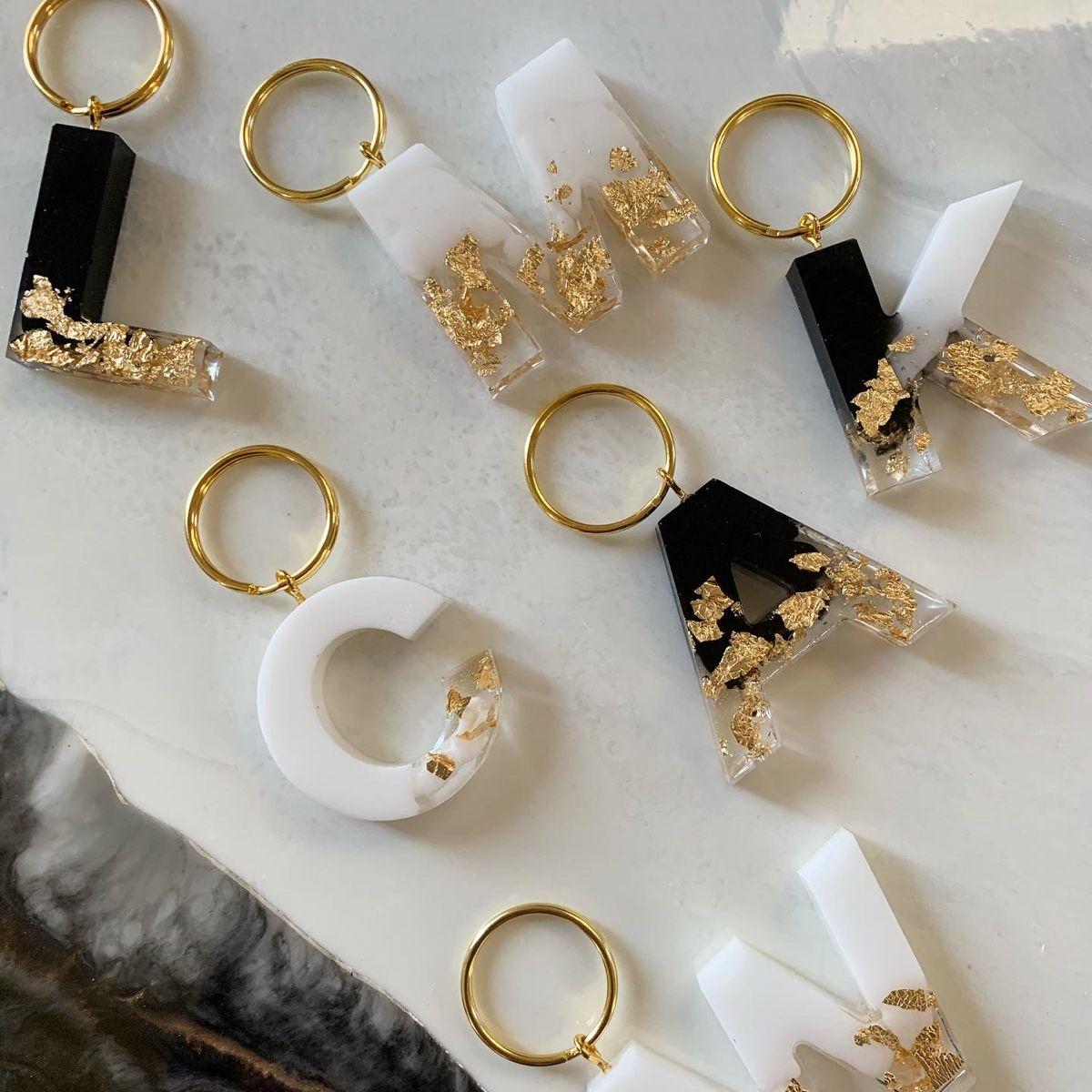 Photo of Black 🖤 or white 🤍✨ custom luxury keychains