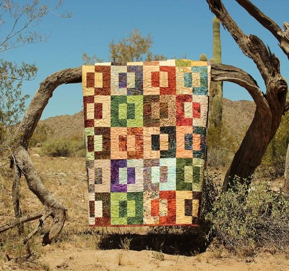 Handmade Patchwork Scrap Lap Quilt In Rust, Green And Brown Batiks - Split Decision from Picsity.com