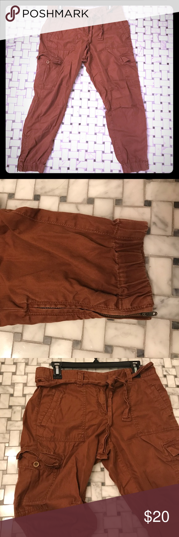 Cargo crops Cargo crop pants with belt tie. Elastic ankle with zipper detail. Too big on me, recently lost weight and sad to let go because they are really comfy to throw on for the weekends. LOFT Pants Ankle & Cropped