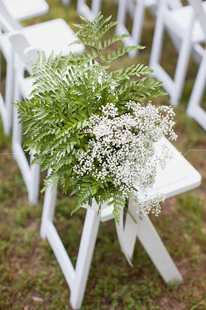 Aisle decor of leather leaf fern and baby\'s breath by Southern ...