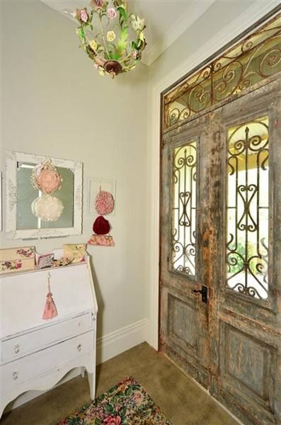 Love these front doors and the chandelier