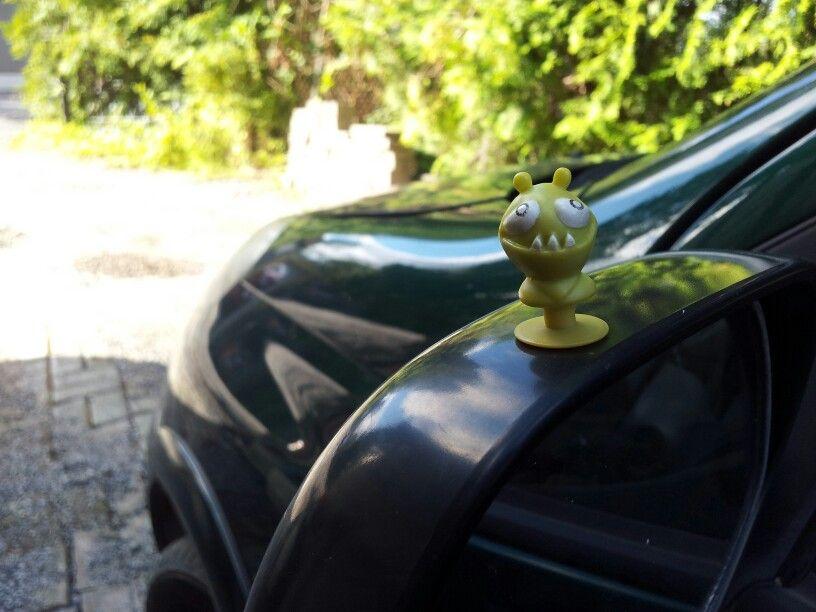 Riding the car.  Alien