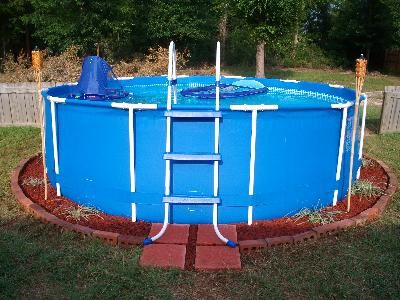 Pin By Sheri Stapleton Allen On Diy Intex Swimming Pool Above Ground Pool Landscaping Backyard Pool Landscaping