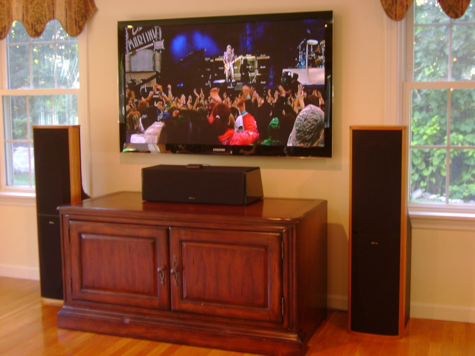 Wall mounted TV with tower speakers and a center speaker placed on the  cabinet Wall mounted TV with tower speakers and a center speaker placed on  . Home Theater Cabinet Design. Home Design Ideas