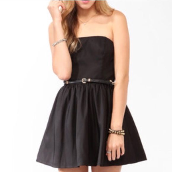 Sexy black straples mini dress Measures:From waist to hem- 15 1/2. Dry clean, No tears, no stains, worn once, It has a small repair on the zipper as shown in the picture. Forever 21 Dresses Mini