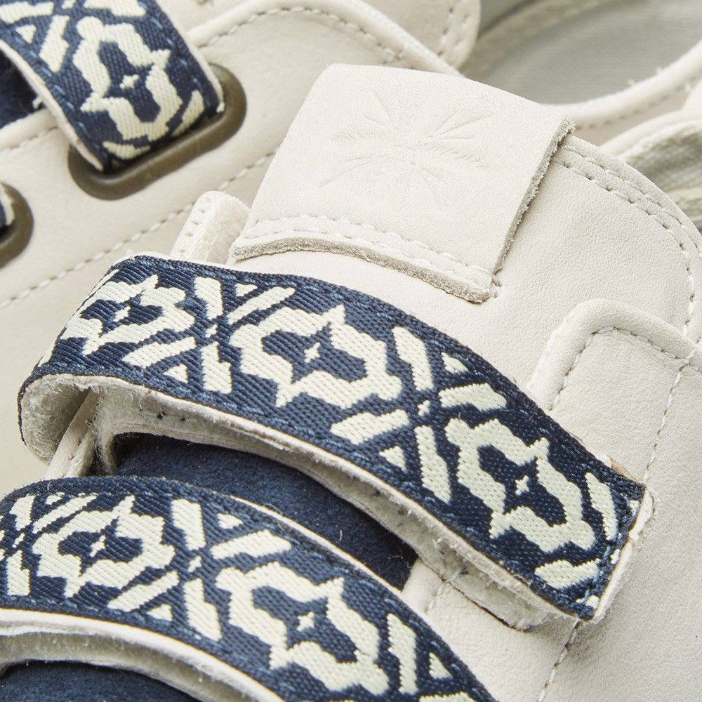 An evolution of a Canvas Court designed in previous collaborations, designer and painter Taka Hayashi re-imagines another Vans Vault silhouette - playing around with the lacing system and adding a series of patterns and textiles. Inspired by his travels up the Californian coast, the Lo Strap LX comes with alternative closures and Native American graphic details, finished with the signature etching to the midsole and logo design at the tongue.  Premium Leather Uppers Suede Toebox & Tongue...