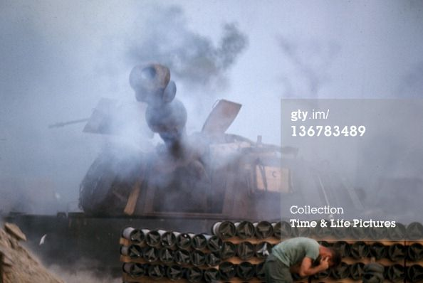 News Photo: An unidentified American soldier plugs his ear and…