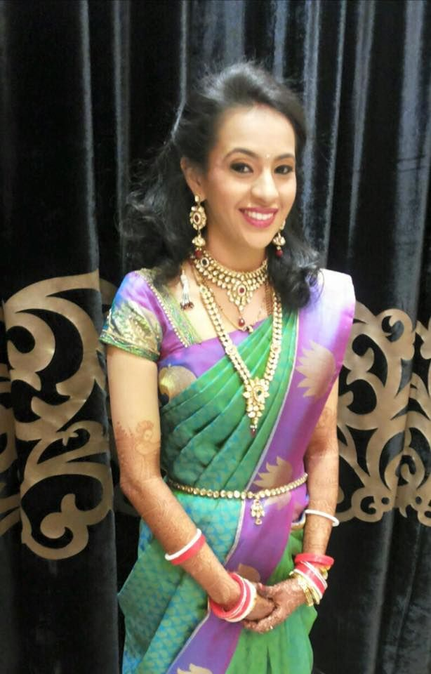 Traditional Southern Indian bride wearing bridal silk saree and ...