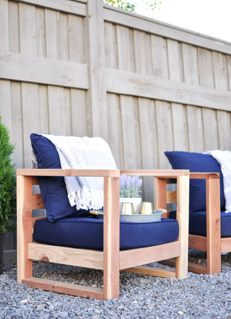 From ashley at cherished bliss this modern diy outdoor chair comes with a super easy tutorial and plans this patio chair project uses just 2x4s and
