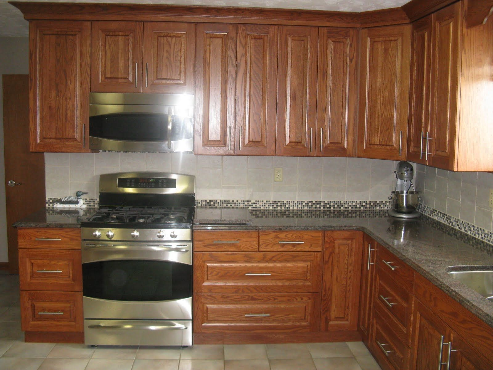 kitchen stainless appliances medium oak FIVE