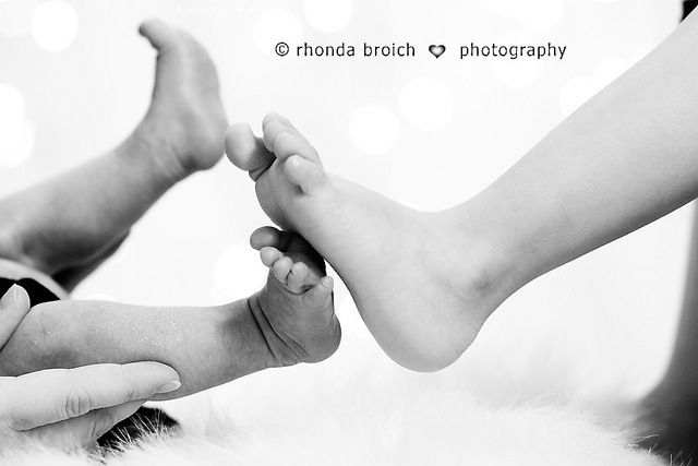 New baby pic- baby feet by big sister feet