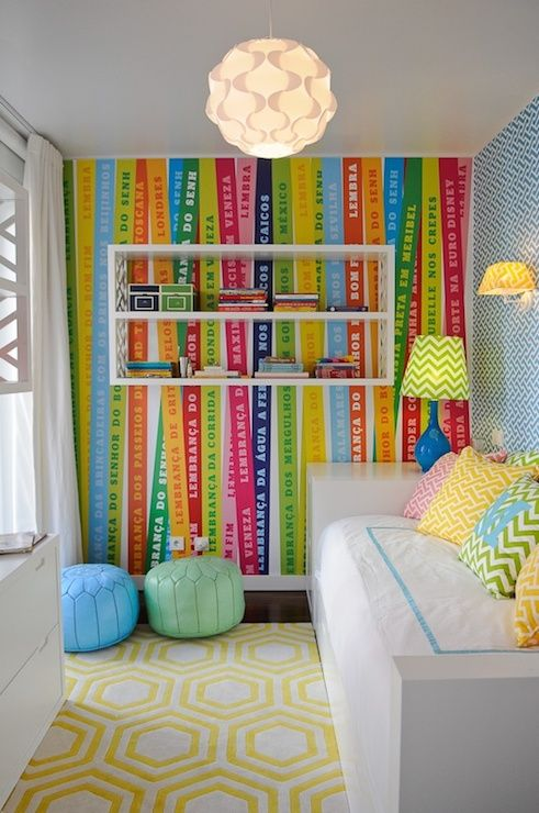 Fun Colorful Kid S Room Features One Wall Clad In Ribbon Wallpaper Adorned With