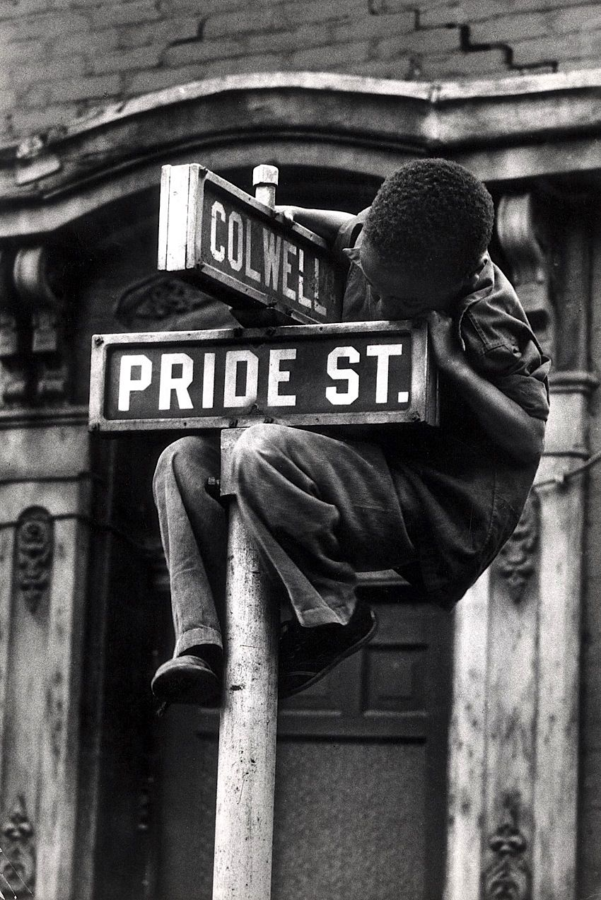 W. Eugene Smith: Pittsburgh (Boy Hanging on Colwell & Pride St. Sign, 1955-56
