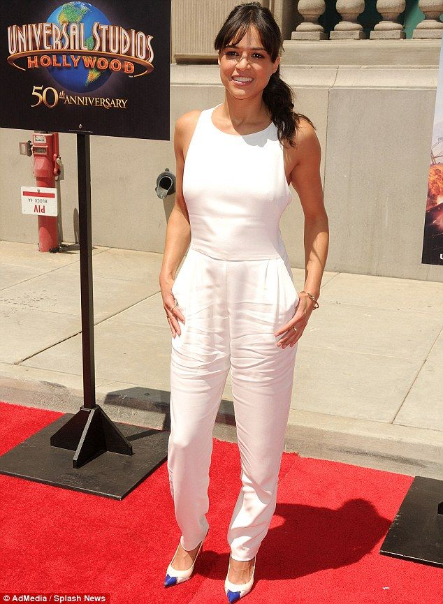 Brunette beauty: The actress donned a sleeveless white jumpsuit along with matching leathe...