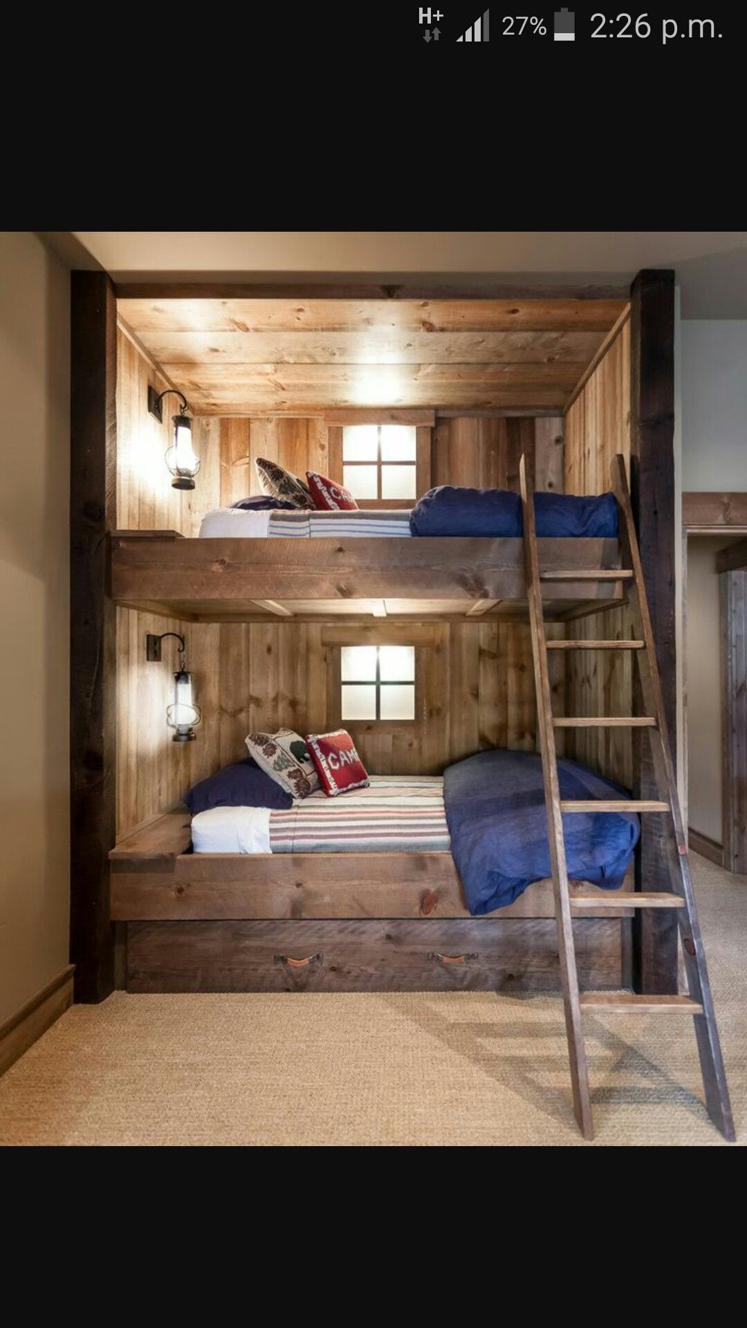 window shaped lights above bed Cabin BUNK ROOMS