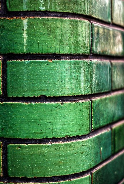 Such a striking alternative to traditional brick, in bright emerald green. would be cool for a backsplash
