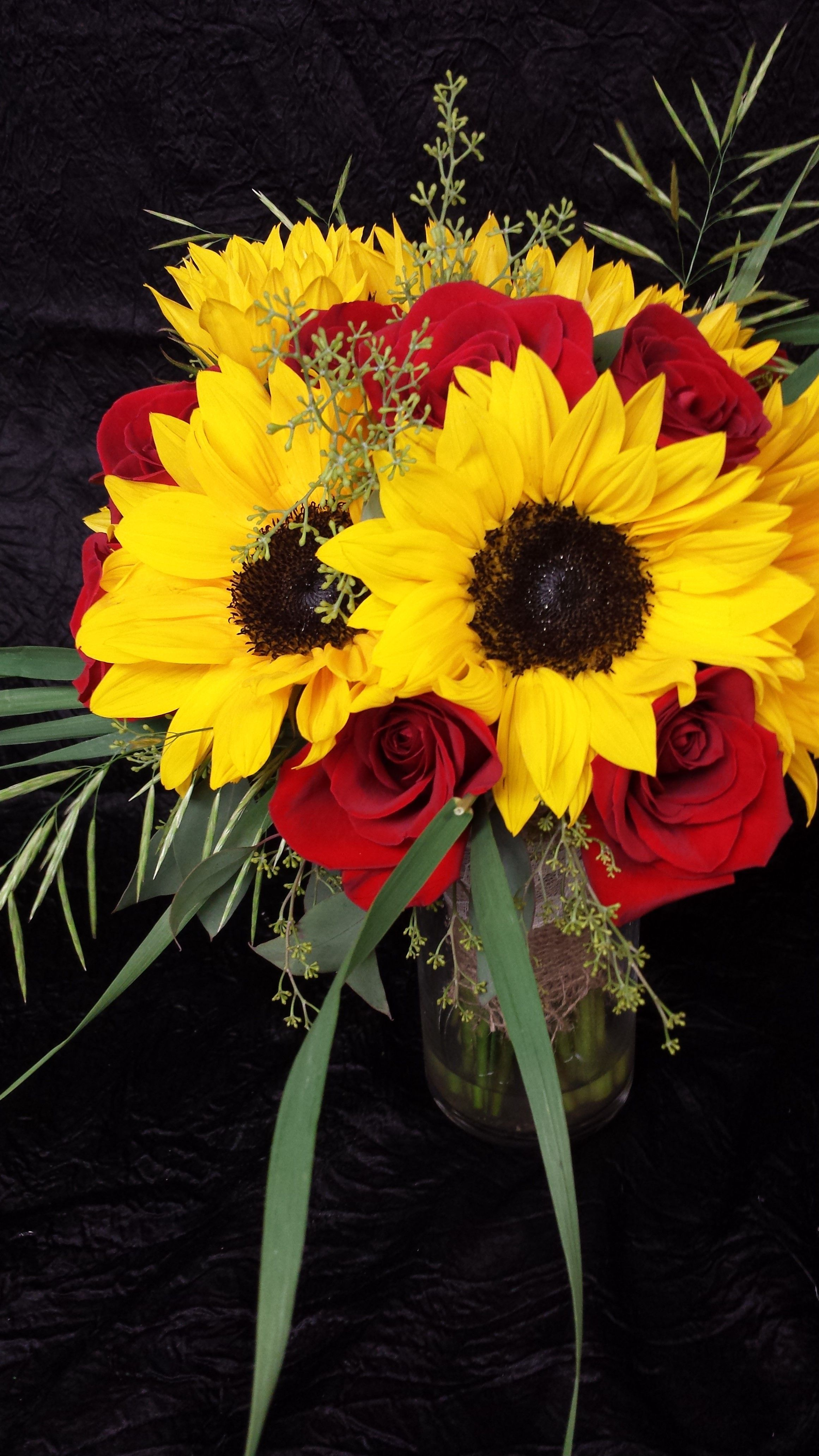 Sunflowers and red rose centerpeice bouquet. In mason jars(: