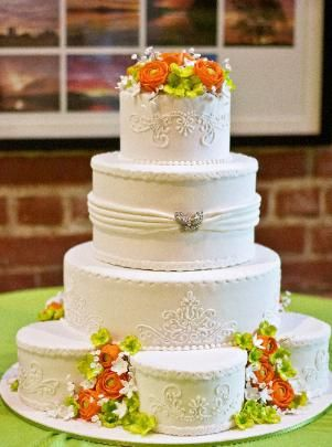 lime green and orange wedding cakes orange and lime green sugar flower adorn this white 16898