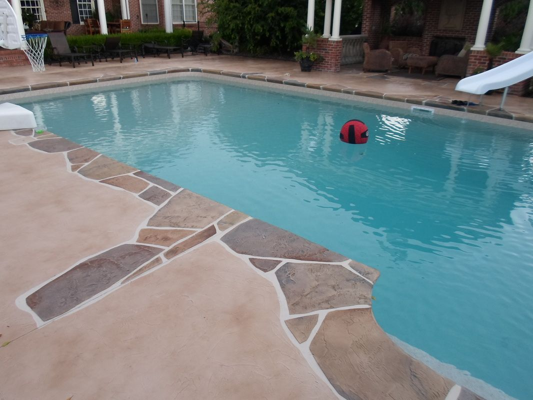 Decorative concrete pool deck overlay spray deck design for Pool design greenville sc