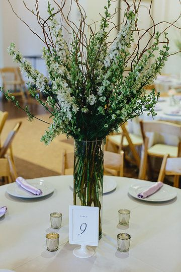 White larkspur and curly willow centerpiece Atlanta Botanical Garden Wedding  Flowers by ufebuckhead.com Photo from emily & jim | wedding collection by Andrew Thomas Lee Photography