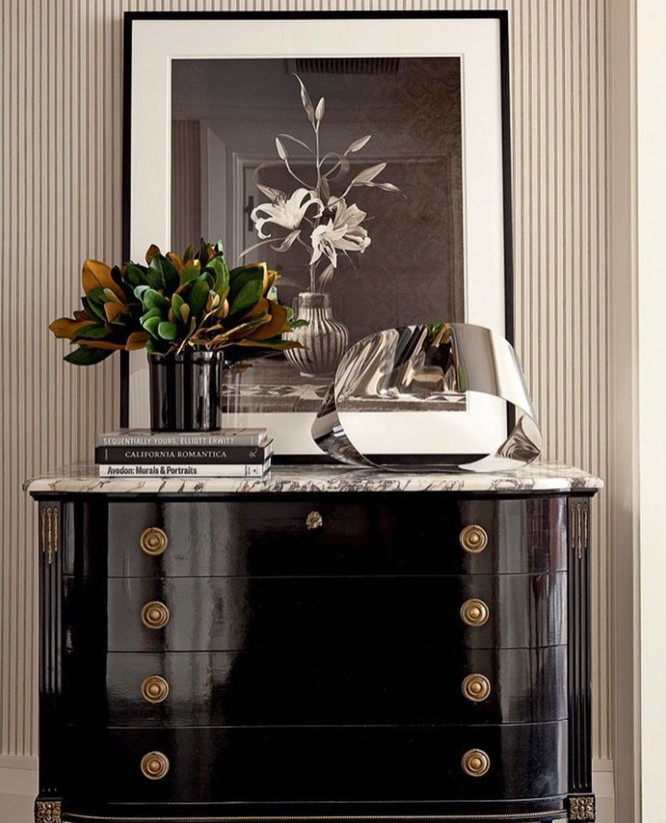 Gorgeous Glossy Black Antique Chest anchors this