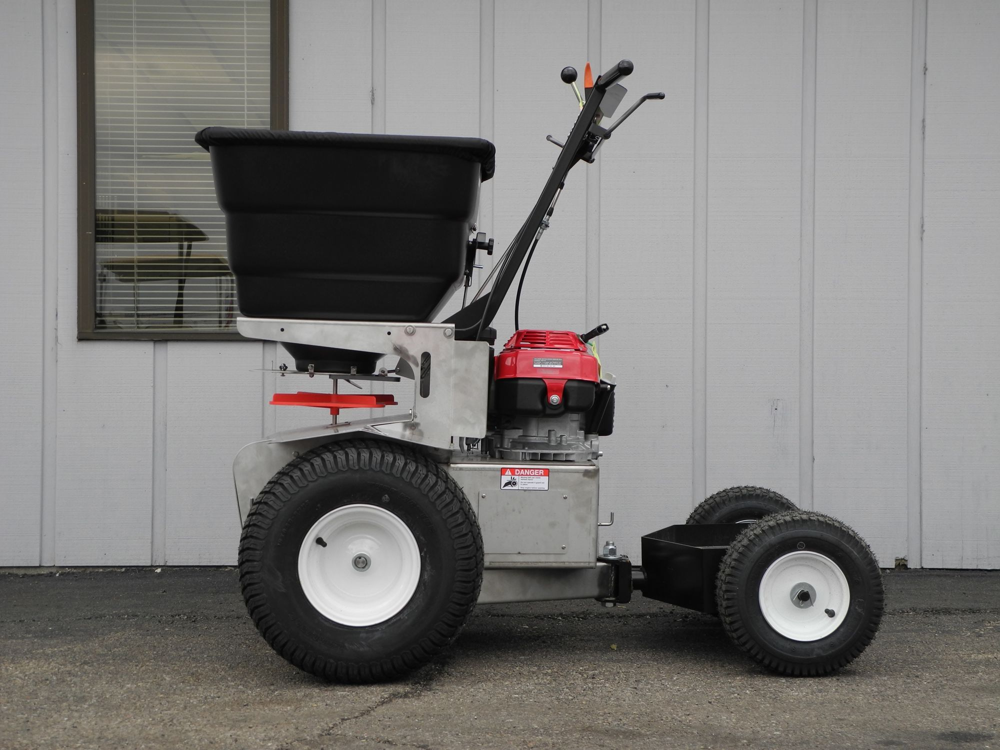 The Prizelawn PS 200 self-propelled ride-on spreader is a