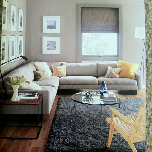 Grey Couch Yellow Pillows Black White Photography Prints Shag Rug On Dark Wood Floors A