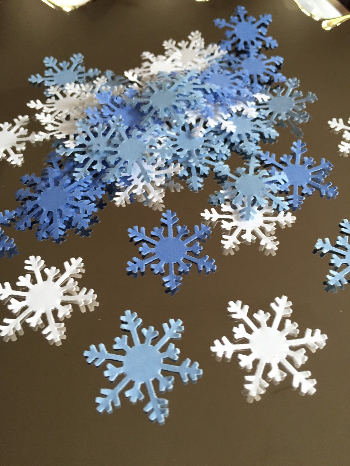 Snowflake confetti 100 count, winter ONEderland, frozen birthday, winter party, baby its cold outside, baby shower, first birthday by MaxandEmsPartyShoppe on Etsy https://www.etsy.com/listing/252385227/snowflake-confetti-100-count-winter