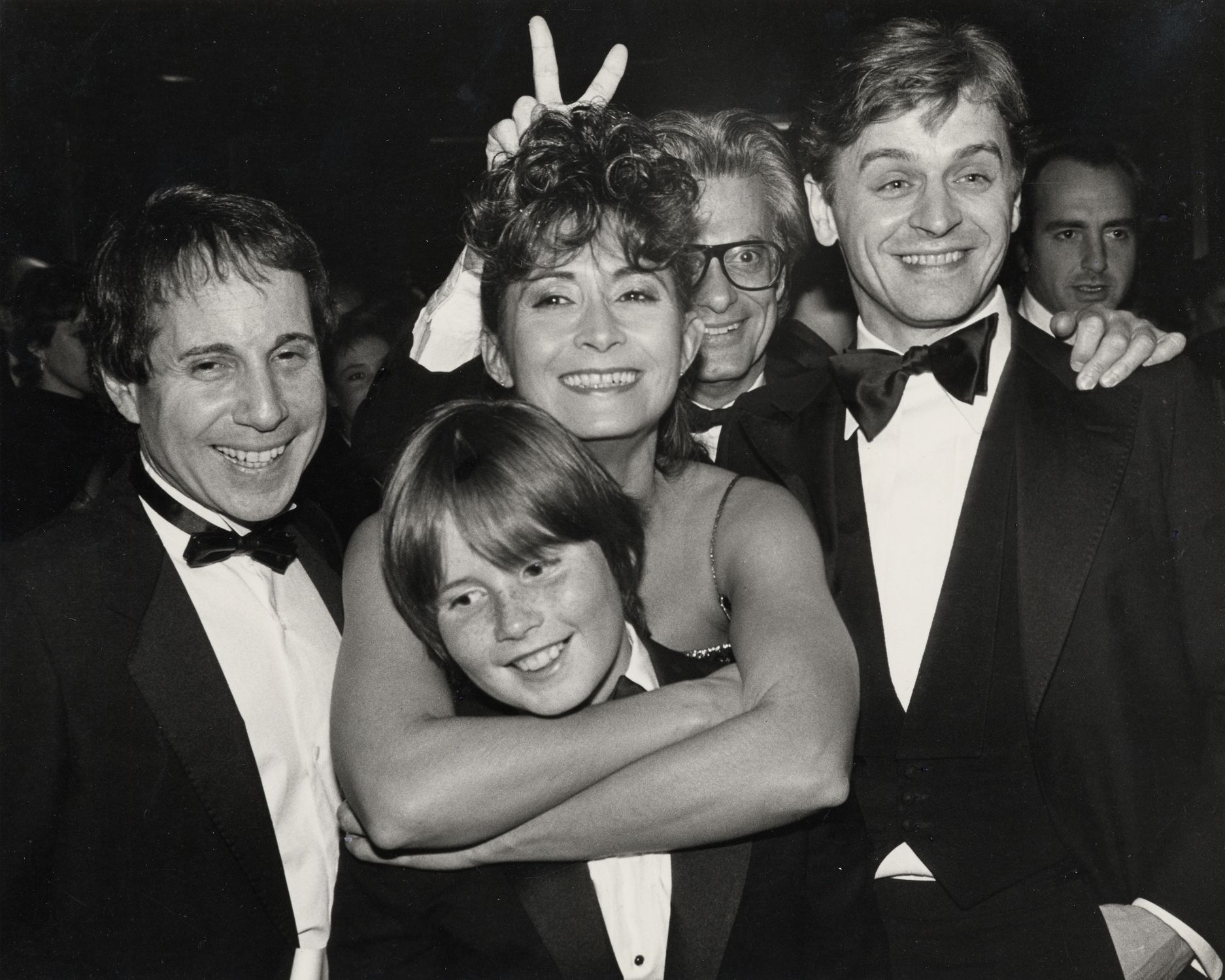 Tharp and her son with Paul Simon (far left), Richard ...