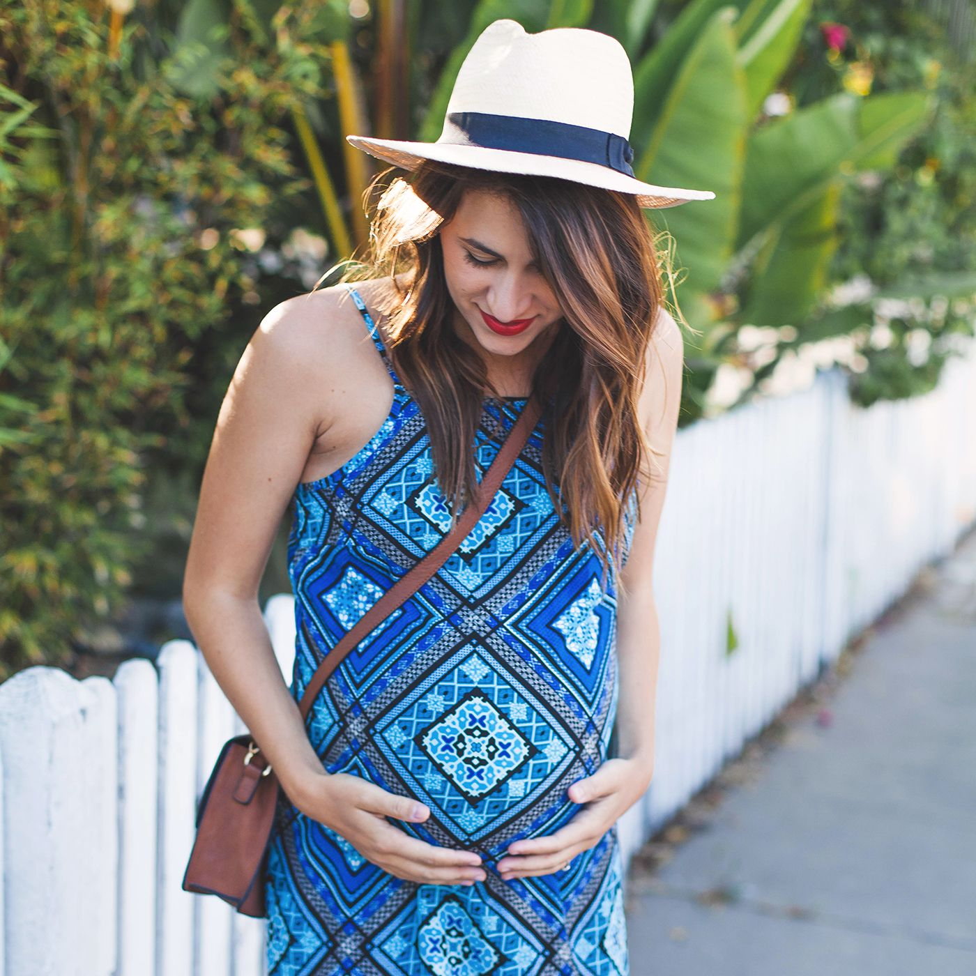 When it comes to feeling stylish and cool while pregnant—the struggle is real. See Natalie from Natalie Dressed's advice for perfect summer maternity style.