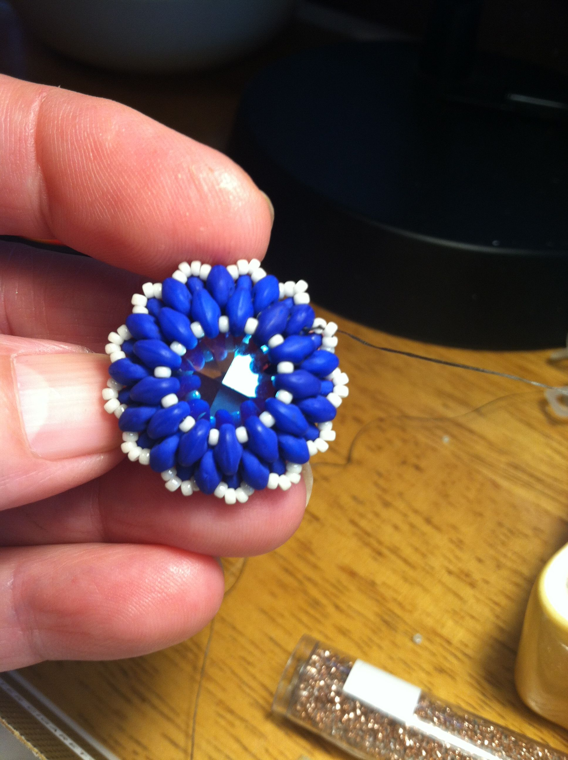 Beautiful Swarovski  crystal surrounded by super duo beads