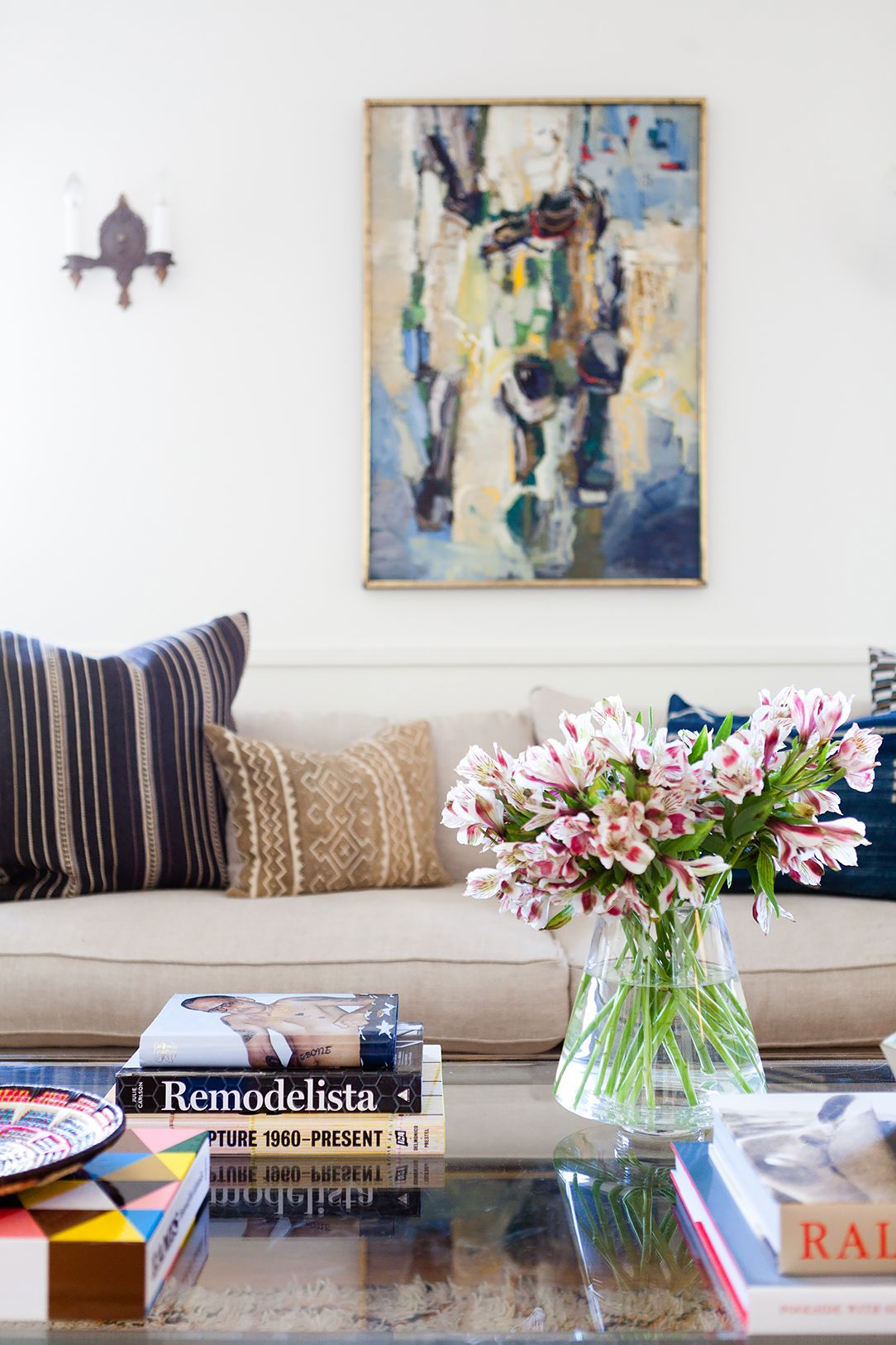 Patterned pillows in a modern meets antique living space