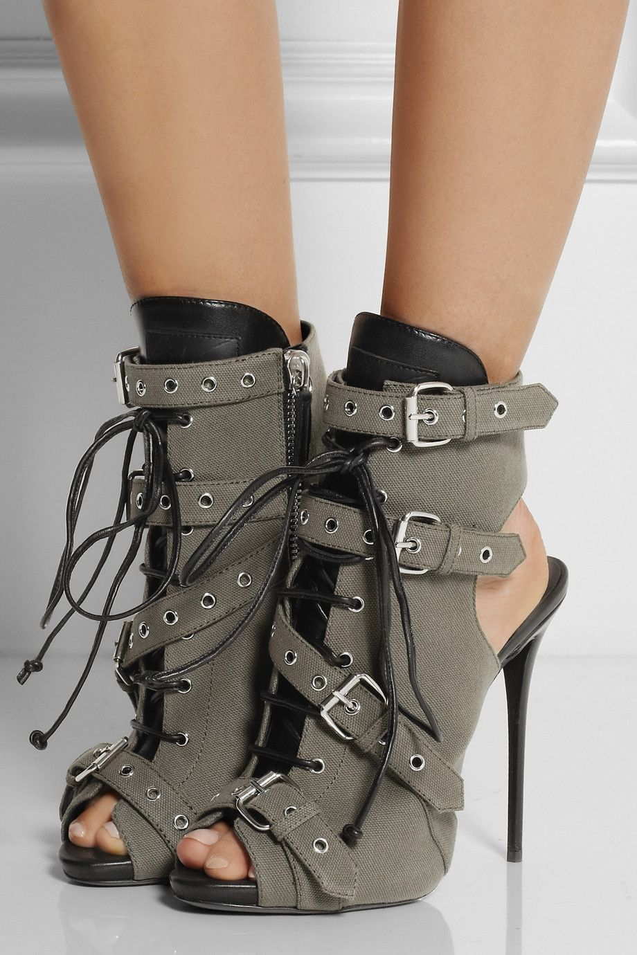 edgy giuseppe zanotti army-green cutout boots with laces, buckles and black  details.