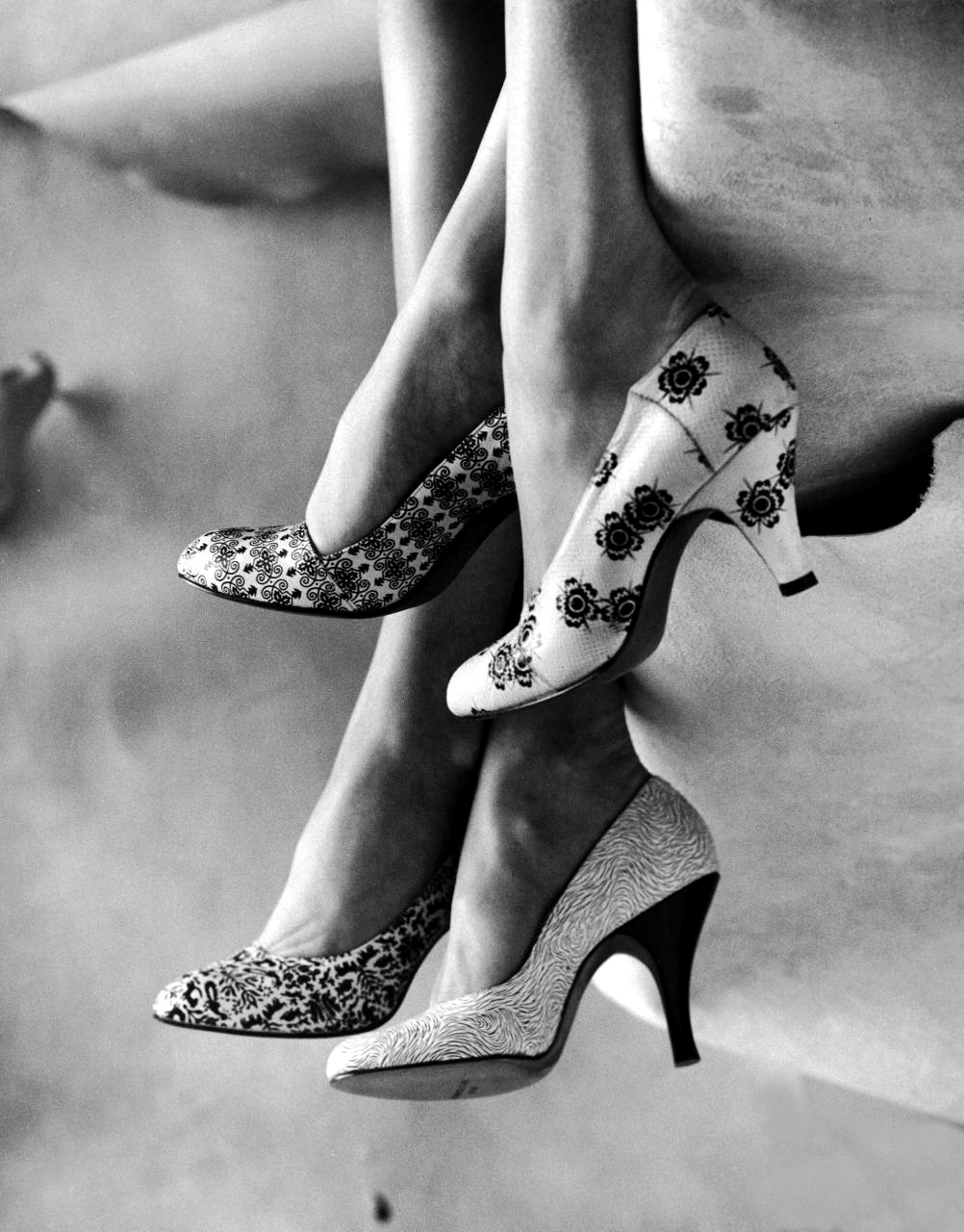 Gordon Parks: Models displaying printed leather shoes. 1956